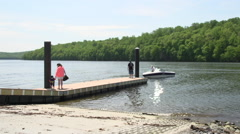 Backing a boat onto the launch Stock Footage