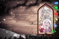 Stock Illustration of Composite image of festive little girl looking surprised