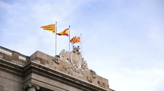 Waving flags of Spain and Catalonia Stock Footage