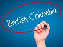 Man Hand writing British Columbia with black marker on visual screen. - stock illustration