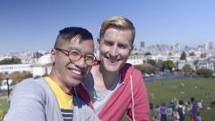 Attractive Gay Couple Take Selfie Together In Dolores Park, San Francisco Stock Footage