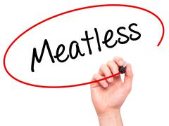 Man Hand writing Meatless with black marker on visual screen. - stock illustration