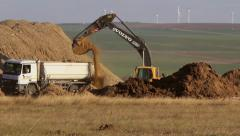 Stock Video Footage of Crawler excavator depositing soil into a dump truck