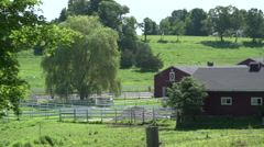Red barn and white fence Stock Footage