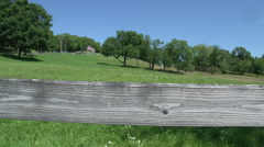 Wood fence line and pasture Stock Footage