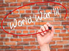 Man Hand writing World War lll with black marker on visual screen. Stock Illustration