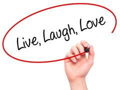 Stock Illustration of Man Hand writing Live Laugh Love with black marker on visual screen.