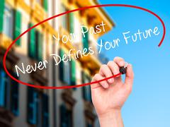 Hand writing Your Past Never Defines Your Future with marker on visual screen. - stock illustration