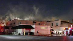 Commercial fire at night with smoke pouring Stock Footage