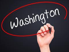 Man Hand writing Washington with black marker on visual screen. Stock Illustration
