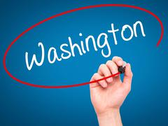 Stock Illustration of Man Hand writing Washington with black marker on visual screen.