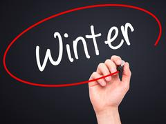 Man Hand writing Winter with black marker on visual screen. - stock illustration