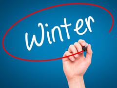 Man Hand writing Winter with black marker on visual screen. Stock Illustration