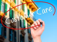 Man Hand writing Customer Care with black marker on visual screen. - stock illustration