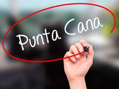 Man Hand writing Punta Cana with black marker on visual screen. - stock illustration