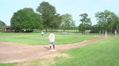 Children Playing Kickball in a Park Stock Footage