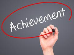 Man Hand writing Achievement with black marker on visual screen - stock illustration