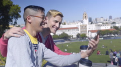 Cute Gay Couple Enjoy Coffee In Park, Take Fun Selfies Together Stock Footage