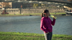 Couple drinking Isotonic After jogging in the city Stock Footage
