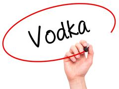 Man Hand writing Vodka with black marker on visual screen. - stock illustration