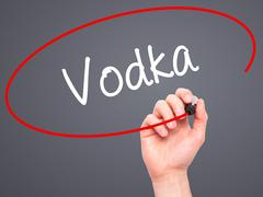 Stock Illustration of Man Hand writing Vodka with black marker on visual screen.