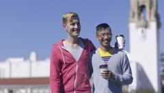 Gay Couple Walks, With Coffee Cups, Through Field In Dolores Park, San Francisco Stock Footage