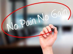 Man Hand writing No Pain No Gain with black marker on visual screen - stock illustration