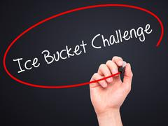 Man Hand writing Ice Bucket Challenge with black marker on visual screen. - stock illustration