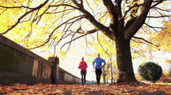 Young Couple Jogging In city park, Super Slow Motion, Low Angle Stock Footage