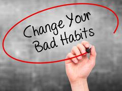 Man Hand writing Change Your Bad Habits with black marker on visual screen. - stock illustration
