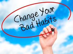 Stock Illustration of Man Hand writing Change Your Bad Habits with black marker on visual screen.