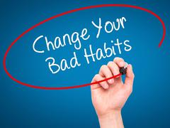 Man Hand writing Change Your Bad Habits with black marker on visual screen. Stock Illustration