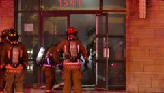 Stock Video Footage of Fire crew making entry into building on fire