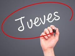 Man Hand writing Jueves (Thursday in Spanish) with black marker on visual screen Stock Illustration
