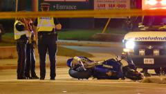 Police on scene investigating a motorcycle collision Stock Footage