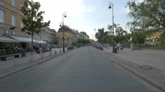 Walking on Krakowskie Przedmiescie street, near Kino Kultura cinema in Warsaw Stock Footage