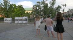 Street performer making soap bubbles on Krakowskie Przedmiescie street in Warsaw Stock Footage