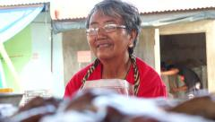 Philippines Fish market lady in front of Squid shift focus Stock Footage