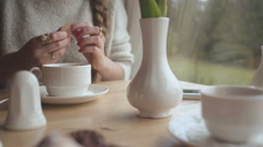 Close up hands of young woman having morning coffee at home. Stock Footage