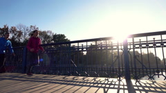 Stock Video Footage of Couple jogging on the bridge, super slow motion