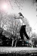 tightrope walker between two trees - stock photo