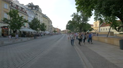 Group of tourists walking on Krakowskie Przedmiescie street in Warsaw Stock Footage
