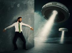 Frightened by UFO - stock photo