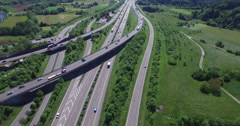 Crane shot of vehicles passing through roads and freeways, Stuttgart, Stock Footage