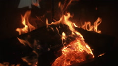 Hot fireplace full of wood and fire. - stock footage
