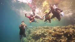 Snorkelling Kids Dive underwater on a tropical water Stock Footage