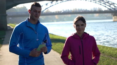 Portrait of young attractive joggers standing in the city, super slow motion Stock Footage