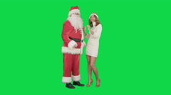 Christmas woman with santa claus dancing on a Green Screen Chrome Key - stock footage