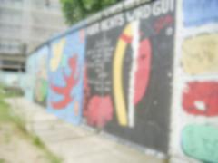Defocused background with remains of the Berlin Wall, Germany Stock Photos