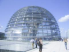 Defocused Background with the Glass Dome of the German Parliament in Berlin.  - stock photo